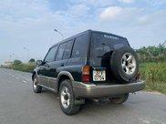 Cần bán lại xe Suzuki Grand vitara đăng ký 2005, màu xanh lục xe gia đình giá chỉ 175 triệu đồng2