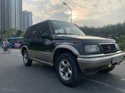 Cần bán lại xe Suzuki Grand vitara đăng ký 2005, màu xanh lục xe gia đình giá chỉ 175 triệu đồng1