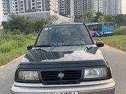 Cần bán lại xe Suzuki Grand vitara đăng ký 2005, màu xanh lục xe gia đình giá chỉ 175 triệu đồng0
