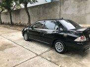 Bán xe Mitsubishi Lancer 2004, màu đen số tự động, 189tr4