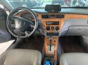 Cần bán gấp Mitsubishi Lancer sản xuất năm 20041