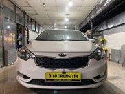 Bán Kia K3 2.0AT sản xuất năm 2014, màu trắng còn mới0