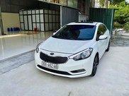 Cần bán lại xe Kia K3 năm sản xuất 2014, màu trắng còn mới0