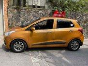 Cần bán xe Hyundai Grand i10 1.0 AT năm 2014, màu vàng, nhập khẩu nguyên chiếc, giá chỉ 288 triệu0