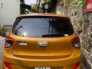 Cần bán xe Hyundai Grand i10 1.0 AT năm 2014, màu vàng, nhập khẩu nguyên chiếc, giá chỉ 288 triệu4