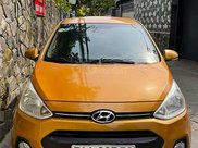 Cần bán xe Hyundai Grand i10 1.0 AT năm 2014, màu vàng, nhập khẩu nguyên chiếc, giá chỉ 288 triệu1