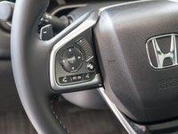 Đánh giá xe Honda CR-V 2018 bản 7 chỗ: Vô lăng bọc da.
