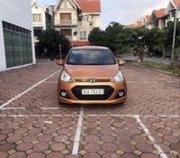 Bán xe Hyundai Grand i10 1.0 AT năm sản xuất 2015, màu cam, xe nhập Ấn Độ