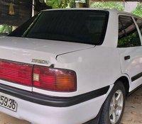 Bán xe Mazda 323 sản xuất năm 1997, màu trắng