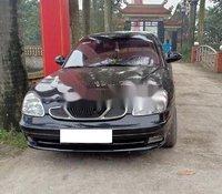Cần bán Daewoo Nubira năm sản xuất 2002, màu đen chính chủ, giá 69tr