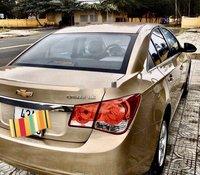 Chính chủ bán xe Chevrolet Cruze năm 2013, màu vàng cát