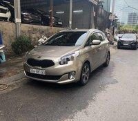Chính chủ bán xe Kia Rondo 2017, màu vàng cát