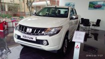 Bán Mitsubishi Triton 4x2 AT số tự động, sản xuất 2018, màu trắng, hỗ trợ vay 70% giá trị xe, liên hệ 0911.821.514