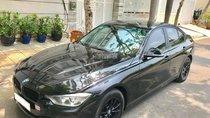 Bán xe BMW 3 Series 320i đời 2013 màu đen, nội thất đen cực sang