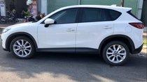 Cần bán Mazda CX 5 2.0 2WD đời 2014, màu trắng xe gia đình
