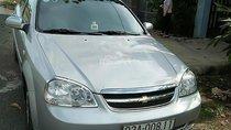 Cần bán xe Chevrolet Lacetti 1.6 đời 2011, màu bạc như mới