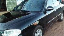 Cần bán lại xe Kia Spectra 1.6 MT sản xuất 2004, màu đen, 128 triệu