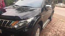 Cần bán Mitsubishi Triton năm sản xuất 2015, màu đen, xe nhập xe gia đình