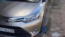 Cần bán lại xe Toyota Vios 1.5E năm sản xuất 2016, màu vàng chính chủ