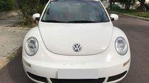 Cần bán lại xe Volkswagen New Beetle 1.6 AT đời 2009, màu trắng, nhập khẩu nguyên chiếc
