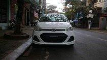 Cần bán Hyundai Grand i10 đời 2014, màu trắng, xe đẹp