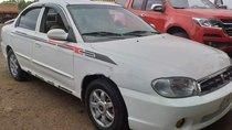 Cần bán gấp Kia Spectra đời 2004, màu trắng, xe nhập chính chủ