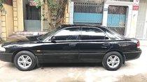 Cần bán xe Mazda 626 1997, màu đen, nhập khẩu nguyên chiếc