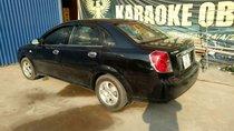 Cần bán gấp Chevrolet Lacetti sản xuất 2004, màu đen