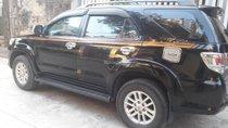 Cần bán Toyota Fortuner 2.5G đời 2013, màu đen xe gia đình
