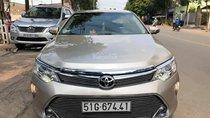 Bán ô tô Toyota Camry 2.5Q 2015, màu vàng