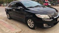 Cần bán lại xe Toyota Corolla altis 1.8G MT đời 2009, màu đen số sàn