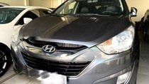 Bán Hyundai Tucson 2.0 AT năm sản xuất 2010, màu xám, nhập khẩu nguyên chiếc