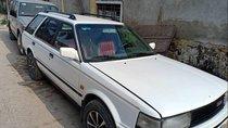 Bán ô tô Nissan Bluebird sản xuất 1990, màu trắng, nhập khẩu, 70 triệu