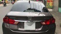 Cần bán nhanh xe. Honda City mua T10/2015, số sàn, màu nâu