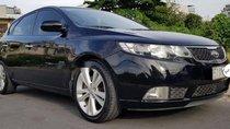 Cần bán lại xe Kia Cerato sản xuất 2010, màu đen, nhập khẩu nguyên chiếc