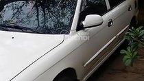 Cần bán xe Kia Spectra sản xuất năm 2004, màu trắng