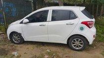 Cần bán xe Hyundai Grand i10 đời 2014, màu trắng, nhập khẩu nguyên chiếc