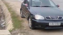 Bán Daewoo Lanos màu đen, đời 2001, xe đang chạy bình thường, gia đình đang sử dụng