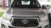 Bán Toyota Hilux 2.4 AT màu bạc, nhập khẩu nguyên chiếc, giá tốt