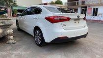 Bán xe Kia K3 1.6 AT đời 2014, màu trắng, giá tốt