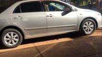 Cần bán gấp Toyota Corolla Altis đời 2009, màu bạc xe gia đình