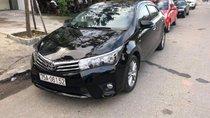 Chính chủ bán Toyota Corolla altis 2015, màu đen, xe nhập