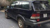 Cần bán lại xe Ssangyong Musso đời 2000, màu đen, máy dầu 2 cầu điện