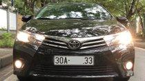 Chính chủ bán Toyota Corolla altis 1.8 AT 2014, màu đen