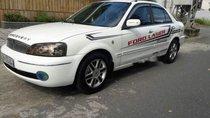 Cần bán xe Ford Laser Limited đời 2003, màu trắng, chạy rất êm ái