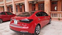 Gia đình cần bán xe Kia K3 2.0AT đời 2014, màu đỏ, giá tốt