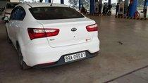 Cần bán lại xe Kia Rio đời 2017, màu trắng, xe không 1 lỗi nhỏ, lốp theo xe nguyên cả dàn