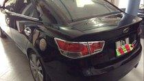 Cần bán lại xe Kia Forte đời 2011, màu đen xe gia đình