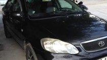 Cần bán gấp Toyota Corolla altis sản xuất năm 2003, màu đen, xe nhập, giá chỉ 250 triệu