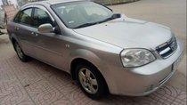 Cần bán gấp Chevrolet Lacetti 2009, màu bạc, 200 triệu